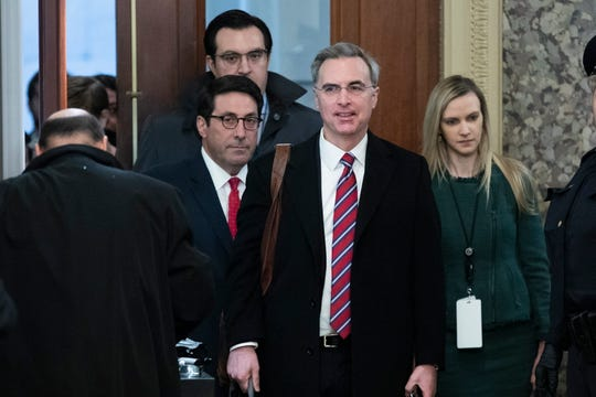 Attorneys for President Donald Trump — Jay Sekulow, left; Jordan Sekulow, back left; and White House Counsel Pat Cipollone, second from right — arrive for the Senate impeachment trial on Jan. 25.