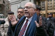 Attorney and retired law professor Alan Dershowitz talks to the press outside federal court, in New York on Dec. 2, 2019.