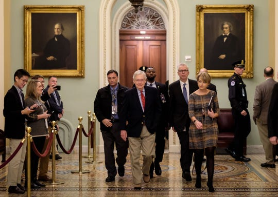 Senate Majority Leader Mitch McConnell walks to his office before the Senate impeachment trial against President Donald Trump on Jan.  25.