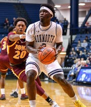 Monmouth guard Ray Salnave drives to the basket against Iona's Isaiah Ross during Monmouth's 73-61 win on Jan. 5, 2020 in West Long Branch.the