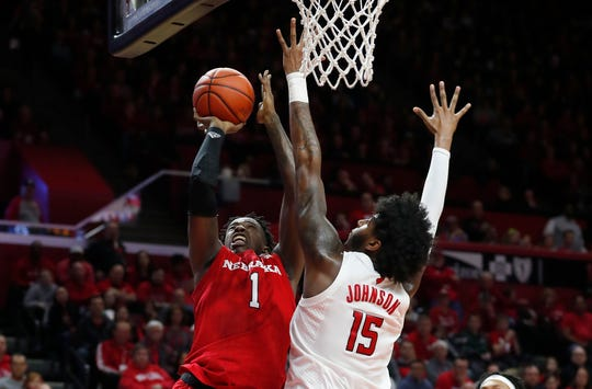 Jan 25, 2020; Piscataway, New Jersey, USA; Nebraska Cornhuskers forward Kevin Cross (1) drives to the basket against Rutgers Scarlet Knights center Myles Johnson (15) during the first half at Rutgers Athletic Center (RAC). Mandatory Credit: Noah K. Murray-USA TODAY Sports