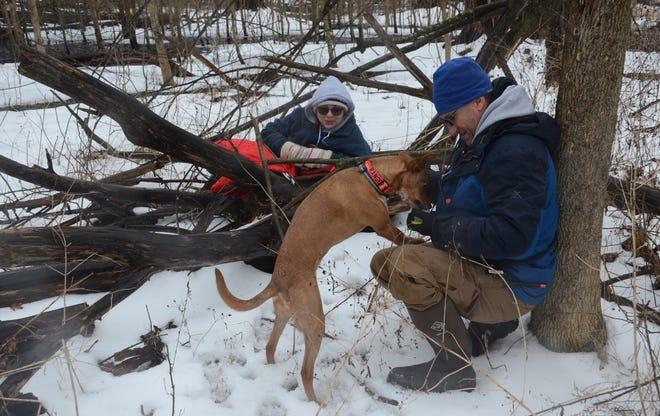 Bill Longenecker rewards Ranger after he found Hillarie Gilliland during Sunday's training.