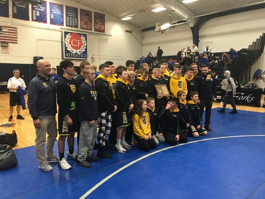 Tioga wrestlers gather after winning Section 4 Dual Meet Division II title Saturday at Chenango Forks. The Tigers defeated Windsor, 40-34 in the final.