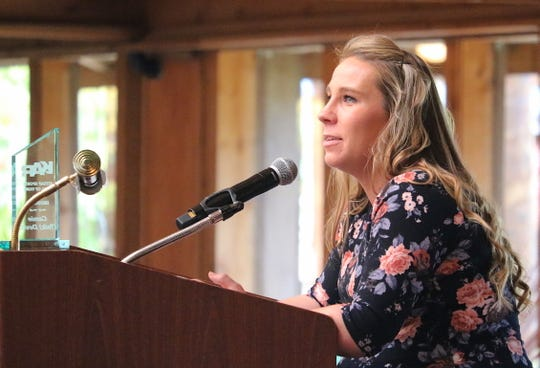 Former Olympic High wrestler Camie (Yeik) Devitt speaks during Saturday's Kitsap Sports Hall of Fame induction ceremony at Kiana Lodge in Poulsbo.
