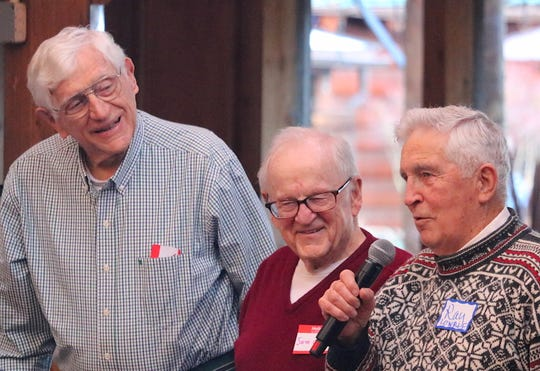 Members of the 1948 Bainbridge boys basketball state championship team (from right to left) Ray Lowrie, Sam Clarke and Bob Woodman address the crowd at Saturday's Kitsap Sports Hall of Fame induction ceremony at Kiana Lodge in Poulsbo.