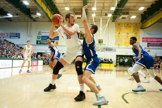 Vermont's Ryan Davis (35) looks to pass the ball during the men's basketball game between the UMass Lowell River Hawks and the Vermont Catamounts at Patrick Gym on Saturday night January 5, 2020 in Burlington, Vermont.