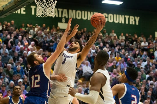 Vermont's Anthony Lamb (3) leaps over Lowell's Josh Gantz (1) to take a shot during the men's basketball game between the UMass Lowell River Hawks and the Vermont Catamounts at Patrick Gym on Saturday night January 5, 2020 in Burlington, Vermont.