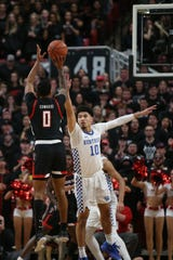 Jan 25, 2020; Lubbock, Texas, USA;  Texas Tech Red Raiders guard Kyler Edwards (0) shoots over Kentucky Wildcats guard Johnny Juzang (10) in the first half at United Supermarkets Arena. Mandatory Credit: Michael C. Johnson-USA TODAY Sports