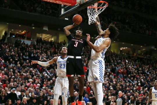Jan 25, 2020; Lubbock, Texas, USA;  Texas Tech Red Raiders guard Jahmi'us Ramsey (3) shoots against Kentucky Wildcats forward Nick Richards (4) in the first half at United Supermarkets Arena. Mandatory Credit: Michael C. Johnson-USA TODAY Sports