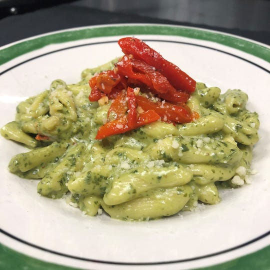 Homemade Cavatelli with Roasted Red Peppers in a Pesto Cream Sauce.