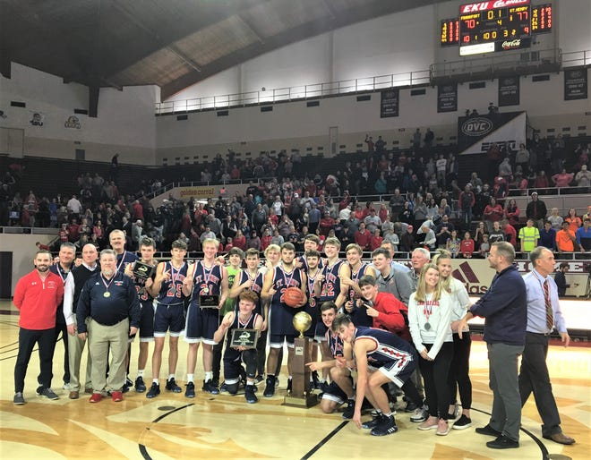 """St. Henry with the championship trophy as St. Henry defeated Frankfort 77-70 in the state championship game of the boys basketball All """"A"""" Classic Jan. 26, 2020 at Eastern Kentucky University's McBrayer Arena, Richmond, Ky."""
