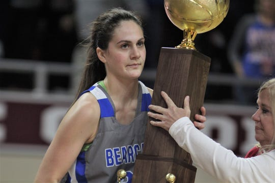"""Walton-Verona senior Emma Gutman accepts the runner-up trophy as Walton-Verona lost 51-47 to Bethlehem in the state championship game of the All """"A"""" Classic girls basketball tournament Jan. 26, 2020 at Eastern Kentucky University's McBrayer Arena, Richmond, Ky. The tournament honored Stan Steidel, its founder and longtime Northern Kentucky athletic coach and administrator who passed away in November, 2019."""