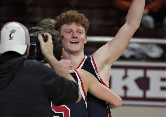 """St. Henry junior Wyatt Vieth celebrates as time runs out as St. Henry defeated Frankfort 77-70 in the state championship game of the boys basketball All """"A"""" Classic Jan. 26, 2020 at Eastern Kentucky University's McBrayer Arena, Richmond, Ky."""