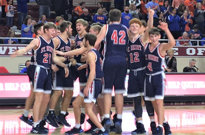 """St. Henry players celebrate after time runs out as St. Henry defeated Frankfort 77-70 in the state championship game of the boys basketball All """"A"""" Classic Jan. 26, 2020 at Eastern Kentucky University's McBrayer Arena, Richmond, Ky."""