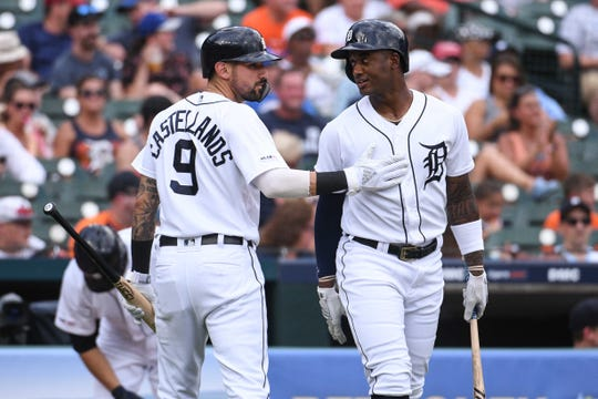 Jul 20, 2019; Detroit, MI, USA; Detroit Tigers right fielder Nicholas Castellanos (9) celebrates his run with left fielder Niko Goodrum (28) during the second inning against the Toronto Blue Jays at Comerica Park. Mandatory Credit: Tim Fuller-USA TODAY Sports