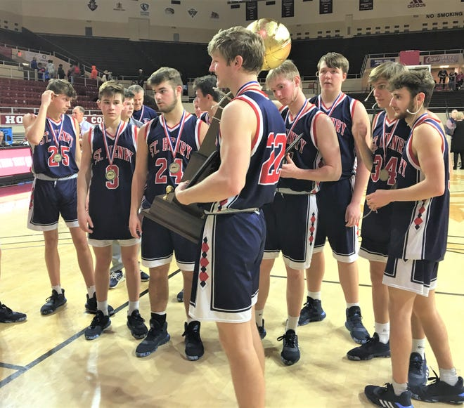 """St. Henry's Jude Bessler with the trophy as St. Henry defeated Frankfort 77-70 in the state championship game of the boys basketball All """"A"""" Classic Jan. 26, 2020 at Eastern Kentucky University's McBrayer Arena, Richmond, Ky."""