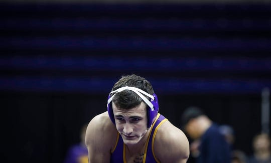 Northern Iowa's Michael Blockhus stares at the Oklahoma State bench prior to the start of his match at 141 pounds against Dusty Hone on Saturday, Jan. 25, 2020, at the McCleod Center in Cedar Falls.