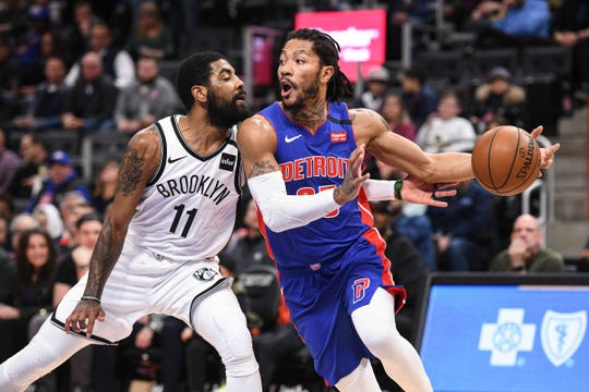 Derrick Rose drives to the basket against Kyrie Irving during the first quarter at Little Caesars Arena, Jan. 25.