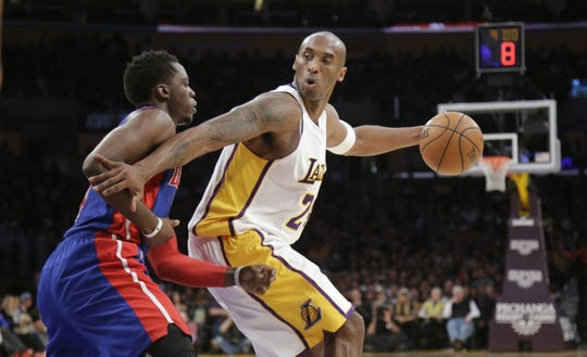 Los Angeles Lakers' Kobe Bryant works against Detroit Pistons' Reggie Jackson during the first half Nov. 15, 2015, at the Staples Center in Los Angeles.
