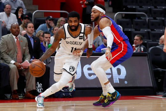 Kyrie Irving drives against Bruce Brown in the first half Saturday at LCA.