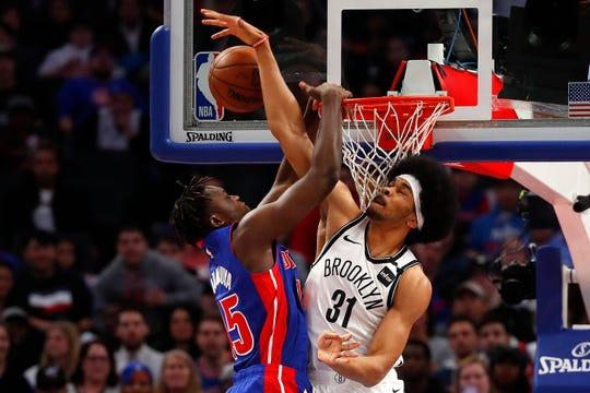 Brooklyn Nets center Jarrett Allen blocks a dunk attempt by Detroit Pistons forward Sekou Doumbouya in the first half in Detroit, Saturday, Jan. 25, 2020.