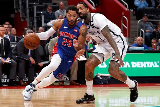 Derrick Rose drives against Nets forward Wilson Chandler in Detroit, Jan. 25.