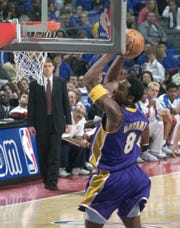 Los Angeles Lakers' Kobe Bryant did a 360 degree spin as he went in for this dunk against the Detroit Pistons in the first half at the Palace in Auburn Hills, Jan. 8, 2002.