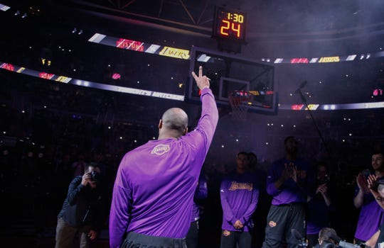 Los Angeles Lakers' Kobe Bryant waves to fans before playing his final game in Detroit against the Pistons on Dec. 6, 2015 at the Palace of Auburn Hills.