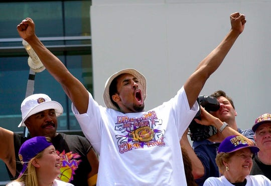 Kobe Bryant celebrates the 2000 NBA championship during a parade June 21 of that year.
