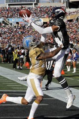 Broncos receiver Courtland Sutton, right, attempts to hold onto a pass as Lions cornerback Darius Slay defends during the first half on Sunday.