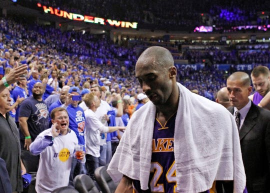 Kobe Bryant walks off the court in May 2012.