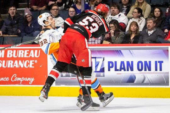 Grand Rapids Griffins defenseman Moritz Seider knocks down the San Diego Gulls' Jack Kopacka in the first period Saturday night at Van Andel Arena in Grand Rapids.