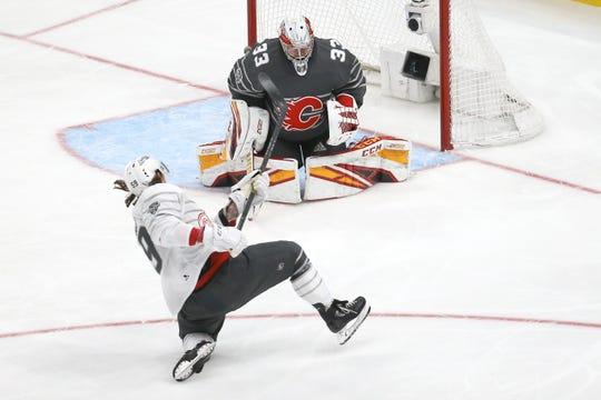 Calgary Flames goalie David Rittich blocks a shot by Detroit Red Wings forward Tyler Bertuzzi.