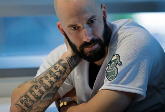 A's pitcher Mike Fiers ponders a question during an interview with the media Friday.