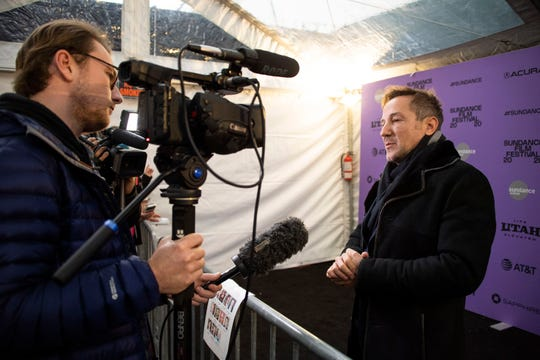 """Director/producer Bryan Fogel speaks to reporters at the premiere of the documentary """"The Dissident"""" at the MARC Theatre during the 2020 Sundance Film Festival on Friday, Jan. 24, 2020, in Park City, Utah."""