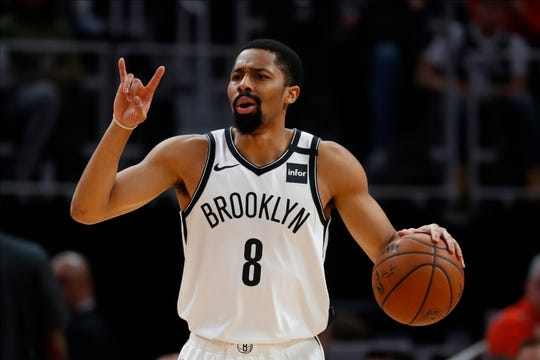 Brooklyn Nets guard Spencer Dinwiddie plays against the Detroit Pistons on Saturday.