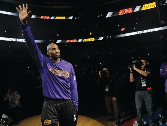 Lakers' Kobe Bryant waves to the fans during pregame introductions at The Palace as he makes his retirement tour in 2015. Bryant was killed in a helicopter crash Sunday, Jan. 26, 2020. He was 41.