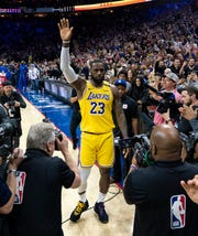 Los Angeles Lakers' LeBron James (23) reacts after moving to No. 3 on the NBA's career scoring list during the second half Saturday against the Philadelphia 76ers in Philadelphia.
