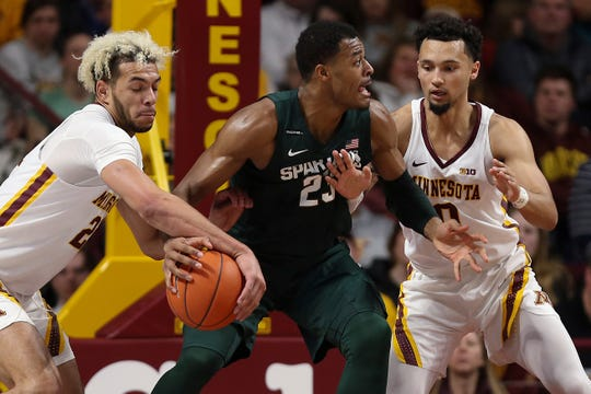 Minnesota's Jarvis Omersa, left, steals the ball from Michigan State's Xavier Tillman during a Big Ten game Sunday in Minneapolis.