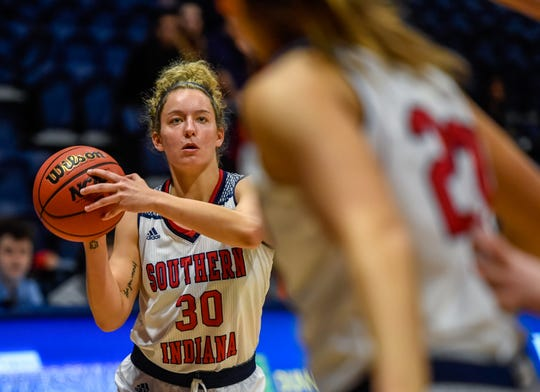 University of Southern Indiana's Emma DeHart (30) looks to shoot as the University of Southern Indiana Screaming Eagles play the Quincy Hawks in a double header at Screaming Eagle Arena Saturday, January 25, 2020.