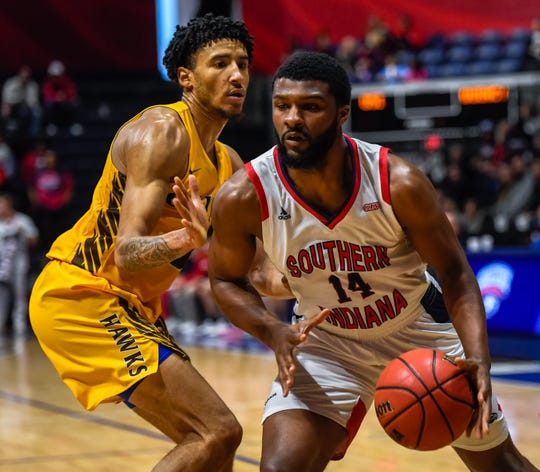 University of Southern Indiana's Emmanuel Little (14) drives past Quincy's Demetrius Houston (3) as the University of Southern Indiana Screaming Eagles play the Quincy Hawks in a double header at Screaming Eagle Arena Saturday, January 25, 2020.