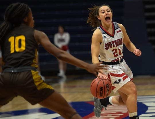 University of Southern Indiana's Addy Blackwell (21) communicates with her teammates as the University of Southern Indiana Screaming Eagles play the Quincy Hawks in a double header at Screaming Eagle Arena Saturday, January 25, 2020.