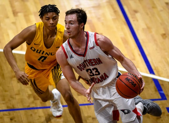 University of Southern Indiana's Chance Coyle (33) drives to the basket under pressure from Quincy's Jah-Kobe Womack (0) as the University of Southern Indiana Screaming Eagles play the Quincy Hawks in a double header at Screaming Eagle Arena Saturday, January 25, 2020.