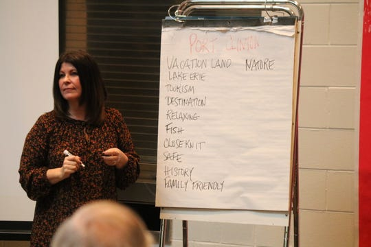Stacy Maple, former director of the United Way in Ottawa County, leads an activity where participants were asked to come up with any words that came to mind to describe the city of Port Clinton during a community meeting on Saturday.