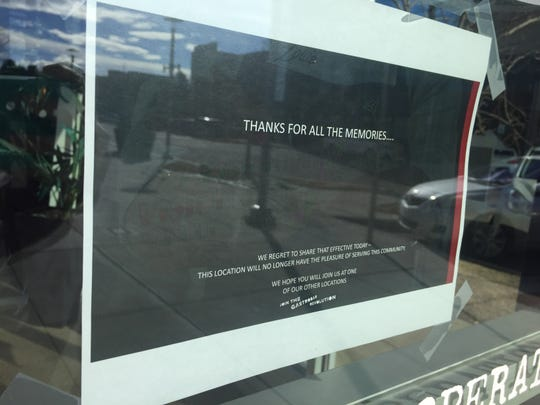 A sign posted in the window of Bar Louie at the Foothills mall notifies customers of its closure, effective Sunday, Jan. 26, 2020.