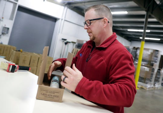 Dean Henrickson, Soda Sense founder, boxes up a carbon dioxide cylinder that will be shipped to a customer on Jan. 9, 2020, in Ashwaubenon, Wis.