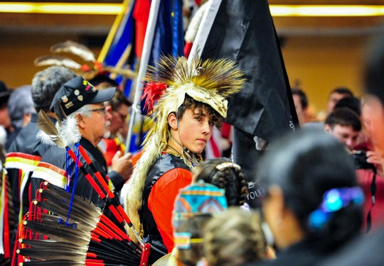 The Little Shell Chippewa Tribe honor guard presents the flags at the beginning of Saturday's dinner celebrating the tribe's federal recognition at the Holiday Inn in Great Falls, January 25, 2020.