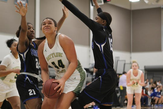 Rocky Mountain College's Markaela Francis, center, is a former star athlete at Great Falls High and Highwood.