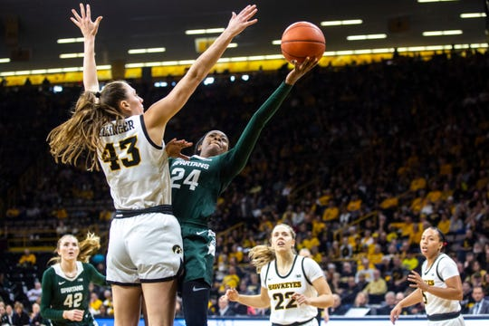 Michigan State Nia Clouden (24) drives to the basket as Iowa forward Amanda Ollinger (43) defends during a NCAA Big Ten Conference women's basketball game, Sunday, Jan. 26, 2020, at Carver-Hawkeye Arena in Iowa City, Iowa.