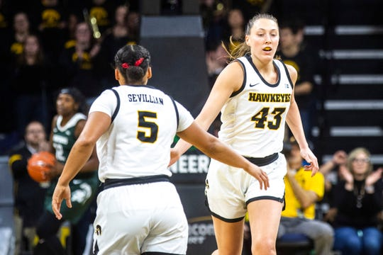 Iowa forward Amanda Ollinger (43) high-fives teammate Alexis Sevillian (5) after making a basket during a NCAA Big Ten Conference women's basketball game, Sunday, Jan. 26, 2020, at Carver-Hawkeye Arena in Iowa City, Iowa.